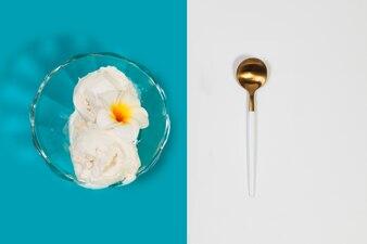 Spoon near bowl of ice-cream