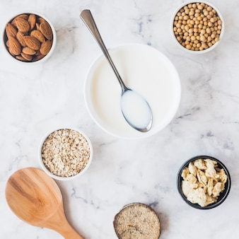 Spoon on bowl with milk on table
