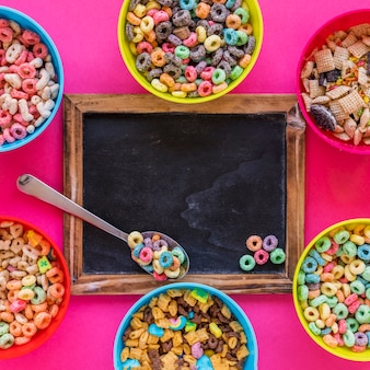 Spoon with cereal on chalkboard
