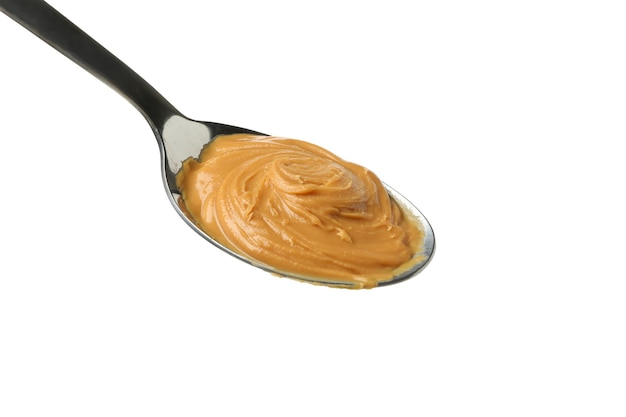 Spoon with peanut butter isolated on white background