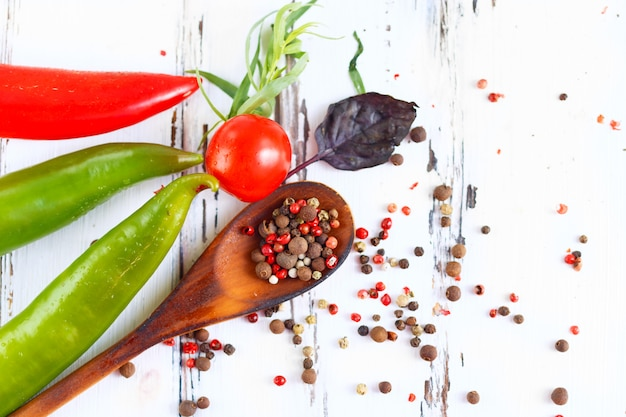 Spoon with spices, cherry, basil chili. ingredients for cooking pasta.