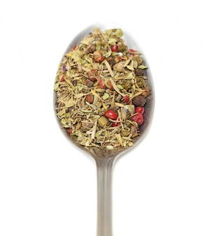 Spoon with spices and white background
