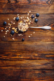 Spoonful of granola and blueberry.