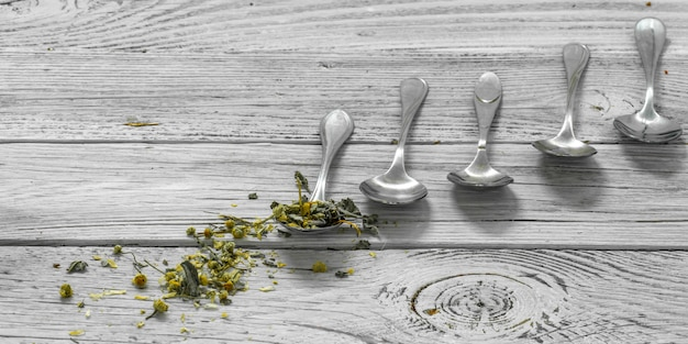 Spoons on a beautiful white wooden background, winter ,autumn