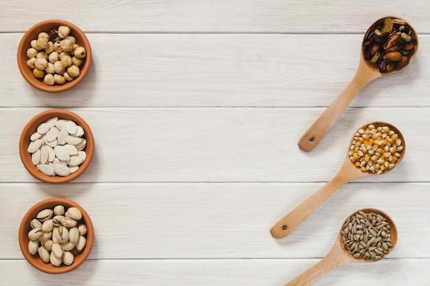 Spoons and bowls with nuts and seeds