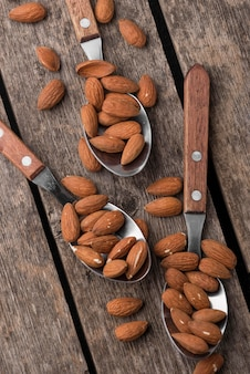 Spoons filled with almond nuts