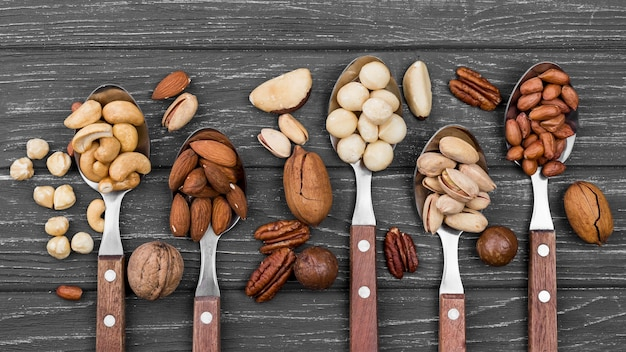 Spoons filled with various nuts
