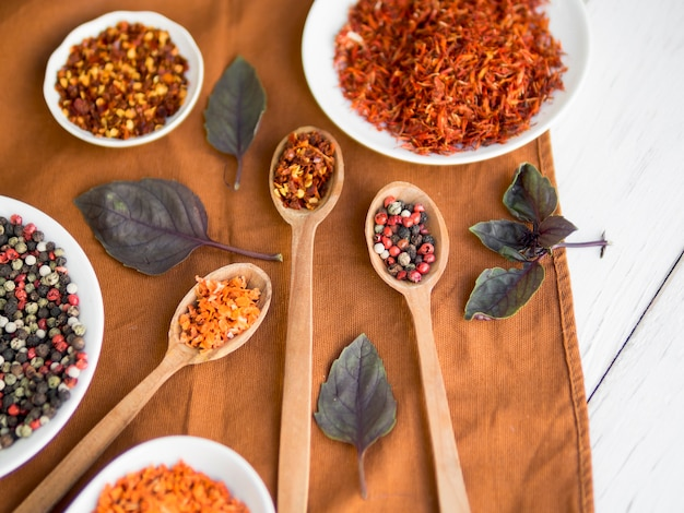 Spoons full spices with dry leaves