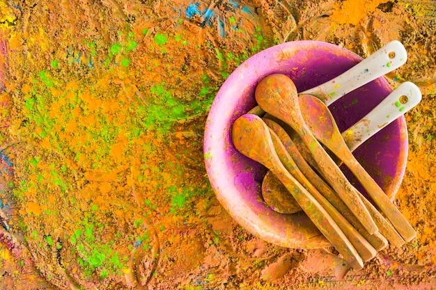 Spoons on painted table