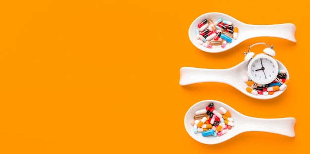 Spoons with pills with copy-space