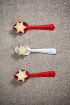 Spoons with red and blue star-shaped cookies