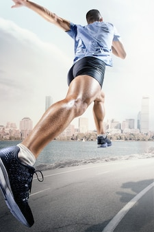 Sport backgrounds. sprinter starting on the running track. collage. advertising concept. the male athlete running against landscape of united states of america