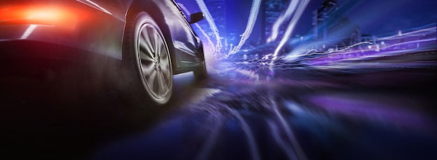 Sport car wheel drifting on night of city lighting background