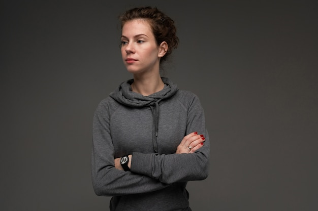 Sport caucasian woman, picture isolated on grey background