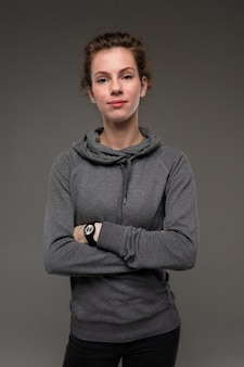 Sport caucasian woman, picture isolated on grey wall