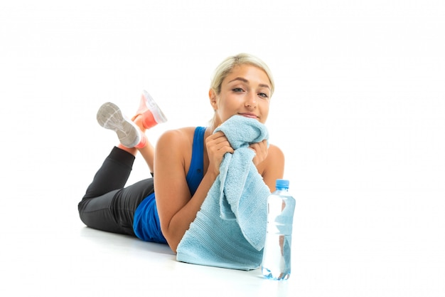 Sport caucasian woman relax with towel and water after hard workout