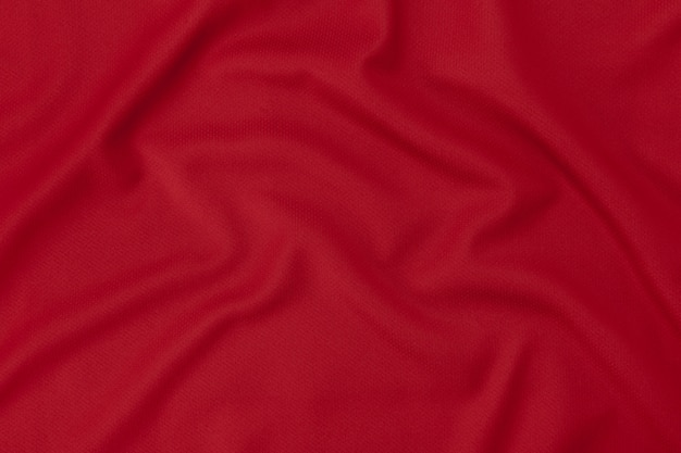 Sport clothing fabric texture background. red football shirt