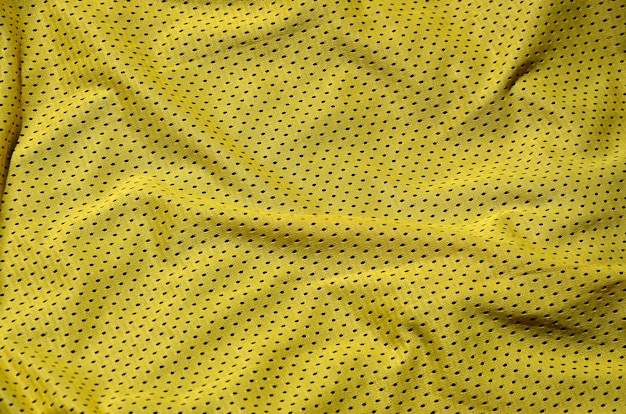 Sport clothing fabric texture background, top view