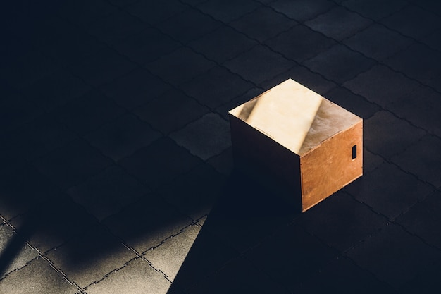 Sport concept, no people. wooden box for jumps of cross training standing at the center of gym. sport equipment, indoors, interior.