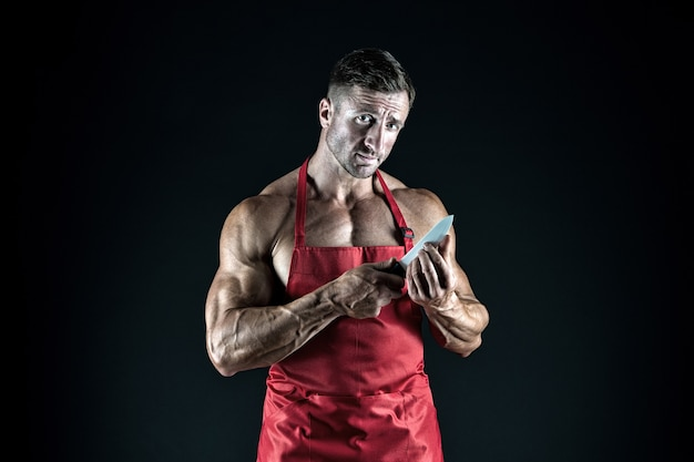 Sport diet. delicious recipe. sexy macho cooking. i will make it tasty. man attractive nude chef wear apron. sexy muscular chef black background. attractive chef cook. muscular chef bodybuilder.