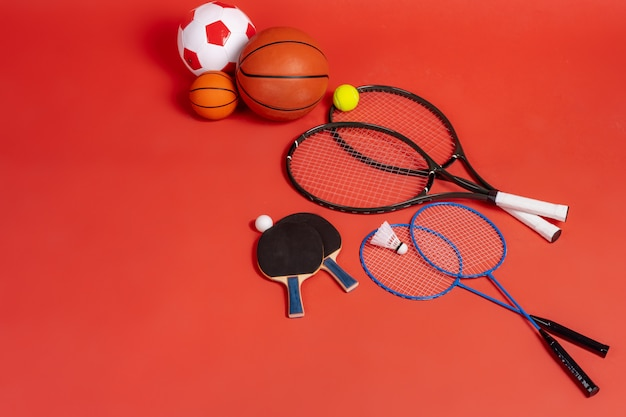 Sport equipment flat lay. variety of rackets and balls