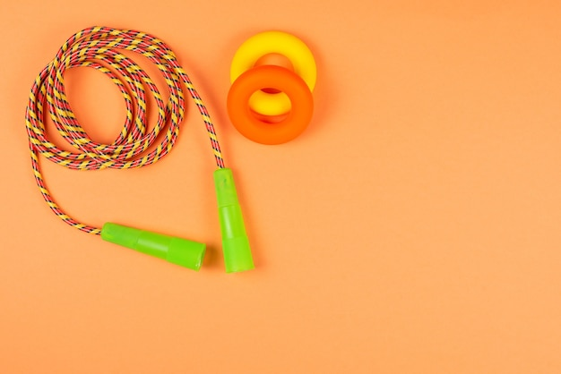 Sport equipment on orange background. copy space.