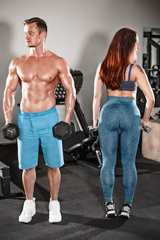 Sport fit couple at gym