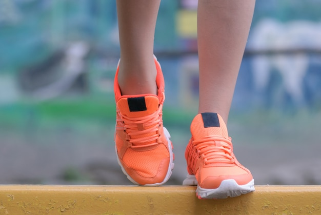 Sport and fitness. close up of female feet with snickers.