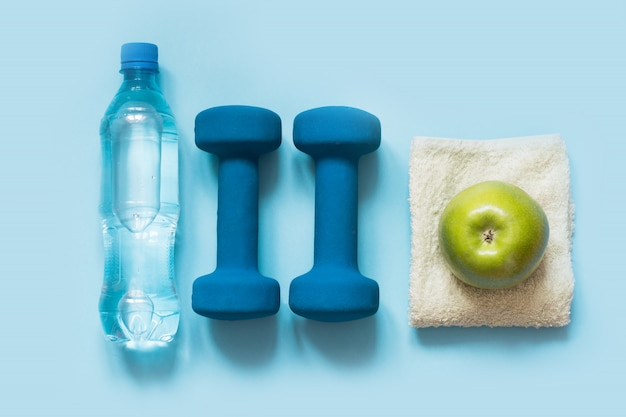 Sport and fitness equipments on blue,