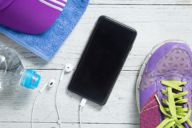 Sport flat lay shoes,smartphone and workout equipments.