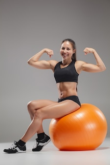 Sport girl doing exercises on a fitball
