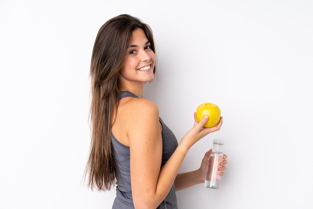 Sport girl over isolated wall