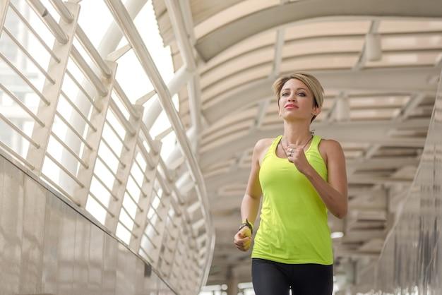 Sport girl running at city