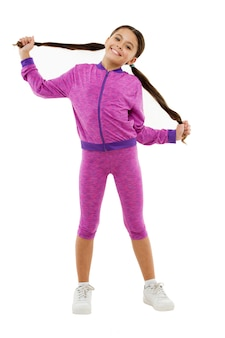 Sport for girls. guidance on working out with long hair. deal with long hair while exercising. working out with long hair. girl cute kid with long ponytails wear sportive costume isolated on white.
