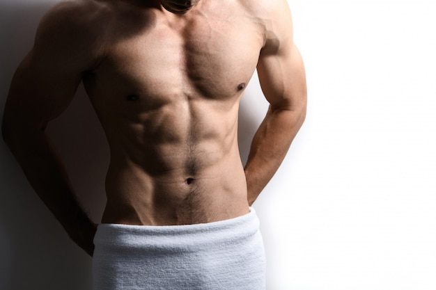 Sport guy, male model with white towel in bathroom