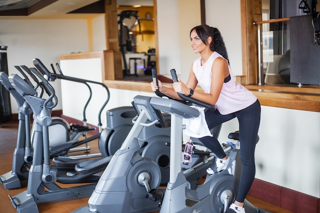 Of sport and healthy lifestyle. exercising legs doing cardio workout on cycling bike