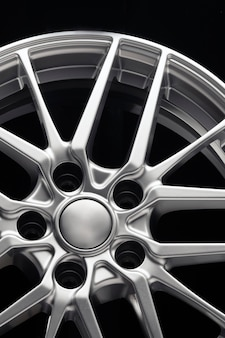 Sport lightweight alloy wheel, spokes and rim front view vertical photo.