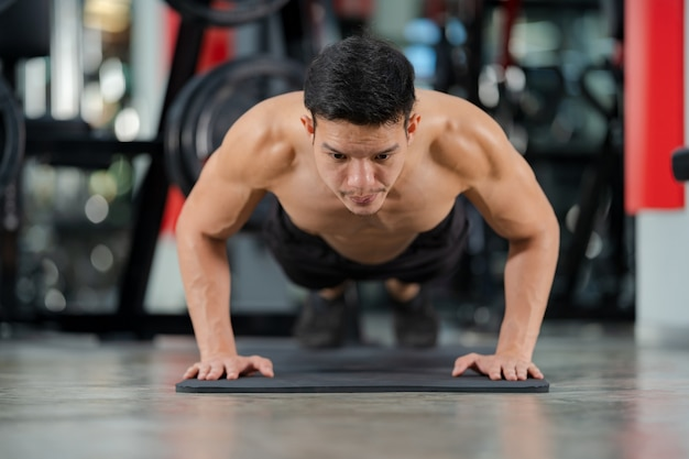 Premium Photo | Perfect strong bodybuilder athletic asian man workout arm  with dumbbell on background.