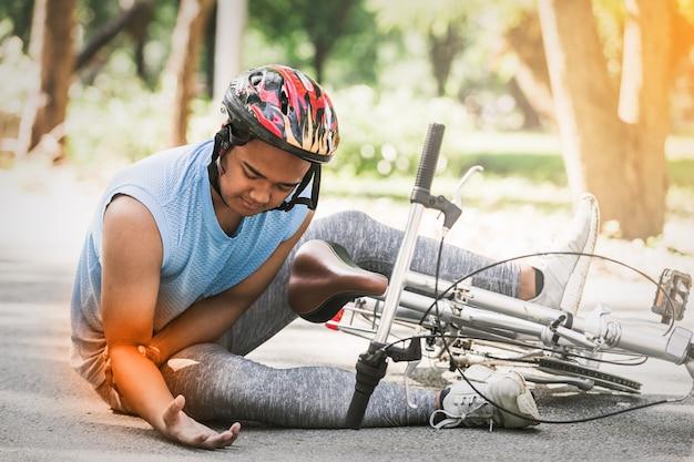 Sport men riding bike injured