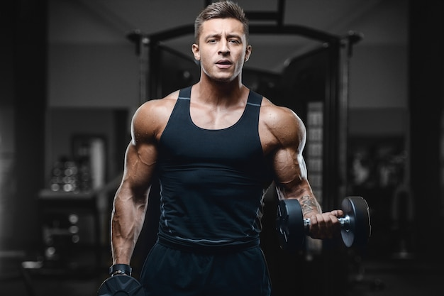Sport muscular fitness man working out at the gym
