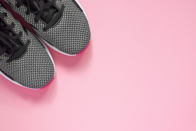Sport shoes. black and white female sneakers for training. lifestyle concept with copy space. top view