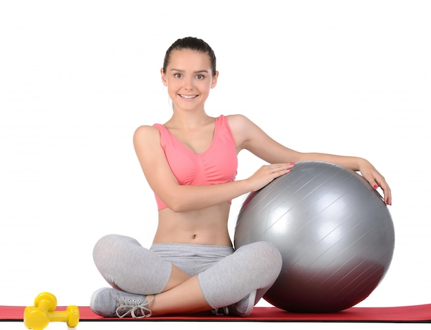 Sport teen woman exercise with the ball.