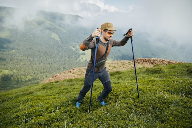 Sport trekking with special equipment and happy hicker