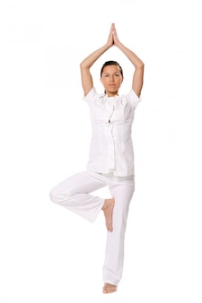 Sport woman doing yoga exercise