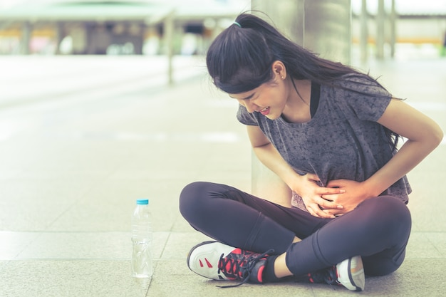 Sport woman is having an injury on her stomachache peroid