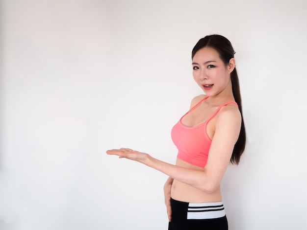 Sport woman show something on her hand,fitness concept