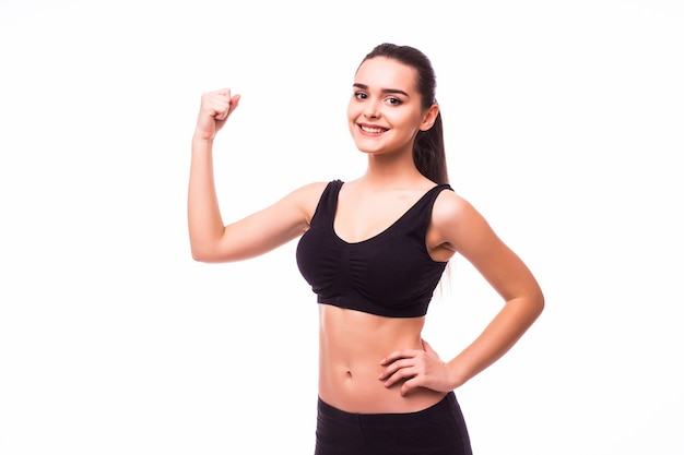 Sport young woman with perfect body showing biceps, fitness girl studio shot over white background