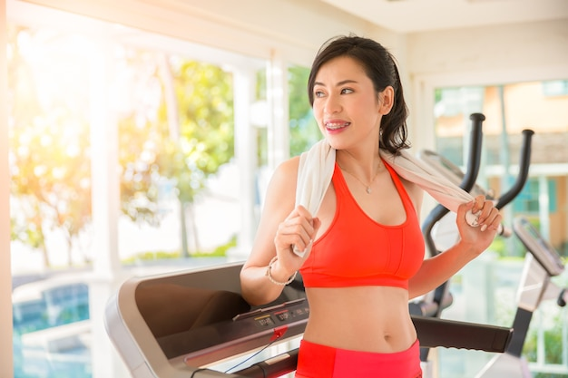 Sportgirl exercise or workout on threadmill at gym