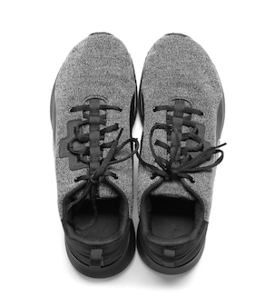 Sportive male shoes on white, top view