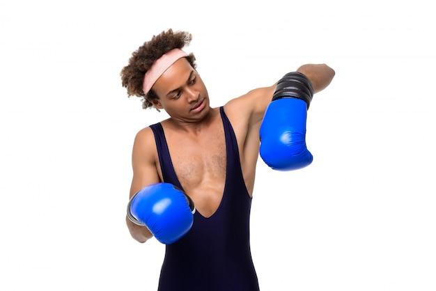 Sportive man in boxing gloves posing